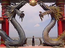 A_visitor_of_Sanggar_Agung_Temple_toke_a_picture_under_the_dragon_statues,_Surabaya-Indonesia (1)