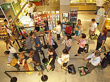 220px-Waiting_in_line_at_a_food_store