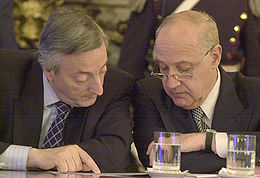 President Néstor Kirchner And Economy Minister Roberto Lavagna, Who Presented The First Debt Restructuring Offer In 2005