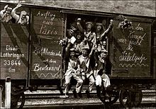 "German Soldiers On The Way To The Front In 1914. A Message On The Freight Car Spells Out ""Trip To Paris""; Early In The War, All Sides Expected The Conflict To Be A Short One."