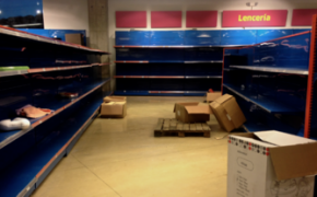 Shortages in Venezuela leave empty store shelves in a store.
