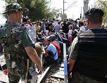 Refugees wait to cross the Greek-Macedonia border, 24 August 2015