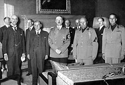 From left to right, Chamberlain, Daladier, Hitler, Mussolini and Italian Foreign Minister Count Ciano as they prepare to sign the Munich Agreement