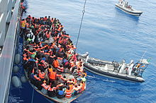Irish Naval Service rescuing migrants from an overcrowded boat as part of Operation Triton, June 2015.