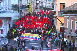 Workers, trade unionists and members of FUT protesting against Correa's policies on 24 June.