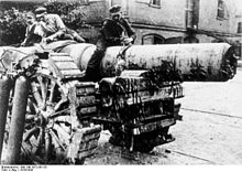 Workmen decommission a heavy gun, to comply with the Treaty of Versailles.