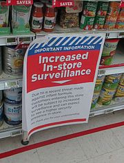 Sign notifying shoppers of increased surveillance due to a perceived increased risk of terrorism