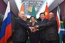Chinese President Xi Jinping holds hands with fellow BRICS leaders at the 2014 G20 Brisbane summit in Australia