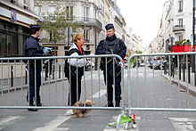 Police patrol in Paris on 14 November, the day after the attacks
