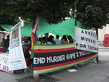 An example of the mounting criticism of President Mugabe. A demonstration in London against his tenure. Protests are discouraged by Zimbabwean police in Zimbabwe.