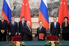 On November 24, 2010, Vladimir Putin announces that Russia's bilateral trade with China will be settled in ruble and yuan, instead of U.S. dollars.