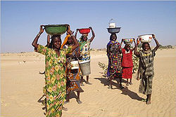 Women in Mao, where water is provided by a water tower. Access to clean water is often a problem in Chad. hence the need for Chinese investment.