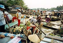 Floating market of Cần Thơ in Vietnam. A symbol of the entrepreneurial spirit of the country.