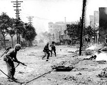 Street fighting during the liberation of Seoul, circa late September 1950.