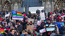 Protesters gather outside Cologne Cathedral after New Year's Eve sexual assaults in Germany, January 2016