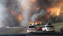 Fort McMurray residents evacuating along Highway 63 in Canada as the fire encroaches on the area