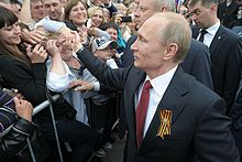 Putin greets local residents during a visit to the Crimean city of Sevastopol on May 9, 2014, after the Russian annexation