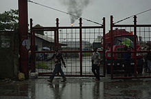 The gates of the Nigerian oil refinery in Port Harcourt.