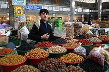 A Tajik dry fruit seller.