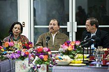 First Lady Rosario Murillo sitting to the left of her husband, Daniel Ortega.