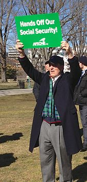 "Older man with sign, ""Hands Off Our Social Security"", Rally in Senate Park, Washington D.C., Feb. 12, 2013."